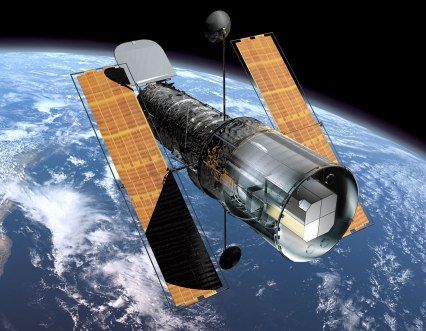 This illustration shows the NASA/ESA Hubble Space Telescope in orbit above the Earth as it looked before the Second Servicing Mission in 1997. The Faint Object Spectrograph (FOS) can be seen (marked in yellow) in Hubble's instrument bay at the back of the observatory. During the Second Servicing Mission the two first generation instruments, FOS and the Goddard High Resolution Spectrograph (GHRS), were replaced by the second generation instruments, NICMOS (Near Infrared Camera and Multi-Object Spectrometer) and STIS (Space Telescope Imaging Spectrograph). A dedicated team effort to understand and correct systematic effects in observations from FOS has now been concluded and the results are released on 11 September 2001. A four-person team based at the Space Telescope-European Coordinating Facility (ST-ECF) in Garching, Germany, has carried out this re-calibration with support from scientists at the Space Telescope Science Institute and the Goddard Space Flight Center. ST-ECF's 'Instrument Physical Modelling Group' has expended ten man-years of effort in understanding the intricate details of the instrument and in developing a novel physical model of its operation. This has allowed them to develop routines to correct for unwanted instrumental and environmental effects in the measurements of stars and galaxies.